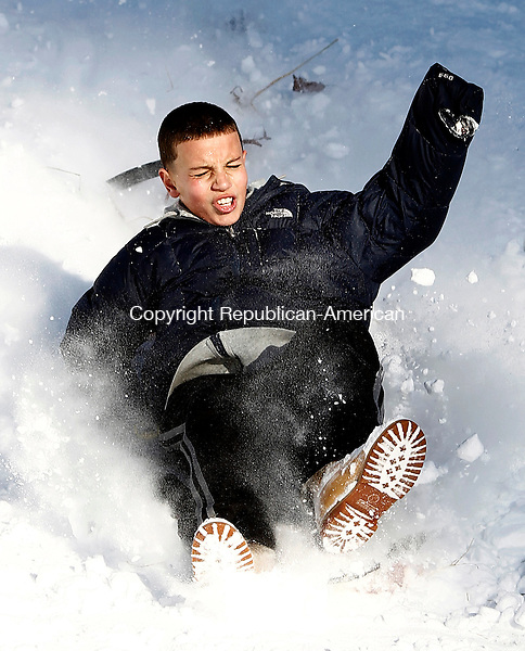 Naugatuck, CT- 03 January 2014-010314CM07-  George Cruz, 12, of Naugatuck takes a sled ride down Hop Brook in Naugatuck Friday afternoon.  According to the National Weather Service, Saturday is expected to be mostly sunny, with a high near 25. The wind chill values could be as low as -7 F.      Christopher Massa Republican-American