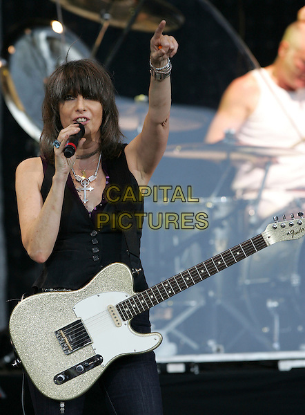 "CHRISSIE HYNDE of THE PRETENDERS.performs live at The 93.1 Jack FM ""Jacks Second Show"" held at The Verizon Wireless Ampitheatre in Irvine, California on August 18 2007.                                                                           half length black on stage gig concert music live guitar fringe hand arm.CAP/DVS.©Debbie VanStory/Capital Pictures"