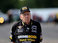 Aug 15, 2014; Brainerd, MN, USA; NHRA funny car driver team owner Jim Dunn during qualifying for the Lucas Oil Nationals at Brainerd International Raceway. Mandatory Credit: Mark J. Rebilas-