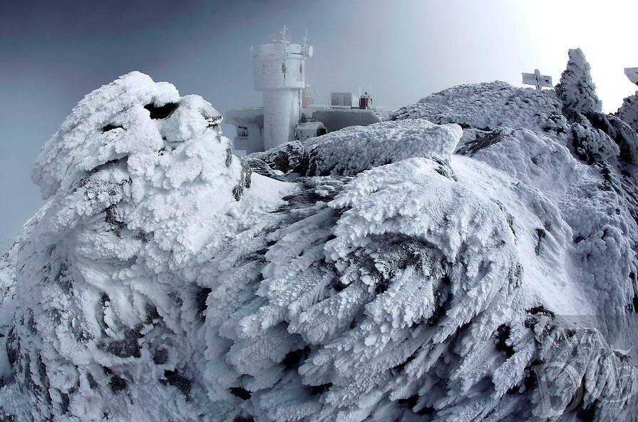 Rime ice covers rocks on the summit of Mount Washington in New Hampshire on Tuesday, March 10, 2015. Rime ice occurs when freezing fog hits stationary objects in frigid conditions. (AP Photo/Robert F. Bukaty)