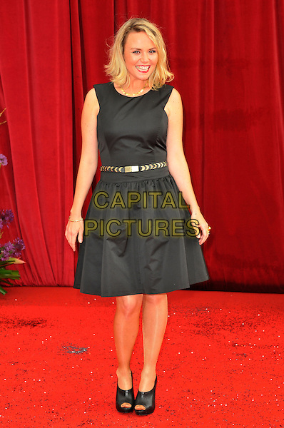 CHARLIE BROOKS .Attending the British Soap Awards 2011, .Granada Television Studios, Quay Street, Manchester, England, UK, .March 14th 2011..arrivals full length black sleeveless dress  gold belt .CAP/CAS.©Bob Cass/Capital Pictures.
