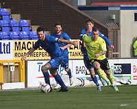 Ross Draper being pressured by Gregg Wylde in the Inverness Caledonian Thistle v St Mirren Scottish Professional Football League Premiership match played at the Tulloch Caledonian Stadium, Inverness on 29.3.14.