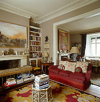 A painting by Anthony Fry hangs above the mian fireplace in the drawing room