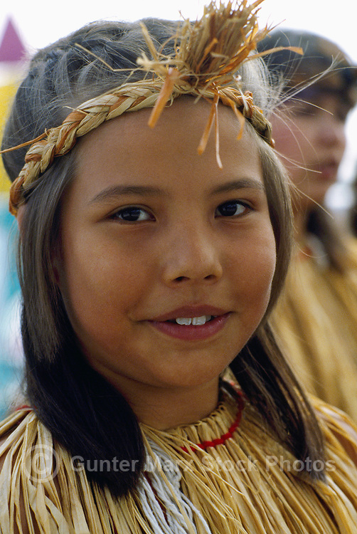 Portrait of Coast Salish Native American Indian Girl wearing Traditional Cedar Bark Costume at Powwow, BC, British Columbia, Canada (No Model Release Available)