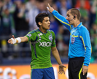Seattle Sounders FC forward Fredy Montero argues with the referee during play against the Vancouver Whitecaps FC at Qwest Field in Seattle Saturday June 11, 2011. The game ended in a 2-2 draw.