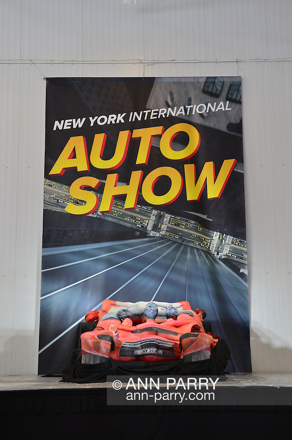 Artist Trina Merry and her Trina Merry Studio created a piece of living art on a stage, where models' bodies were painted and then positioned to resemble a red car, on view at the Media Party after the first day of the New York International Auto Show 2016, at the Jacob Javits Center. The artwork recreated the NYIAS official poster. This was Press Preview Day one of NYIAS, and the Trade Show will be open to the public for ten days, March 25th through April 3rd.