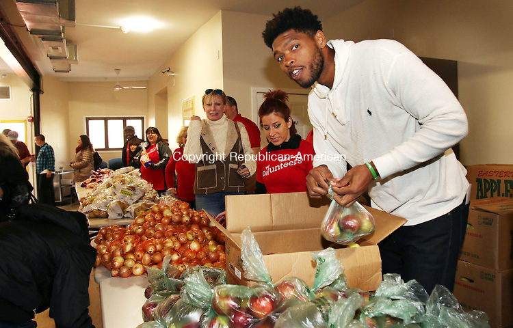 WATERBURY CT. 24 November 2015-112415SV03-Ryan Gomes of Waterbury along with members fro Wells Fargo and UConn Waterbury hand out 372 meals to the needy at Greater Waterbury Interfaith Ministries in Waterbury Tuesday.<br /> Steven Valenti Republican-American