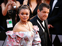 Andra Day arrives at the Oscars on Sunday, March 4, 2018, at the Dolby Theatre in Los Angeles. (Photo by Eric Jamison/Invision/AP)