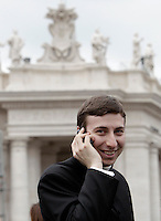 Un sacerdote parla al cellulare in Piazza San Pietro in occasione del primo Angelus di Papa Francesco dalla finestra del suo studio, Citta' del Vaticano, 17 marzo 2013..A priest uses his mobile phone in St. Peter's square prior of the Pope Francis' first Sunday Angelus prayer from hisl studio window at the Vatican, 17 March 2013..UPDATE IMAGES PRESS/Riccardo De Luca -STRICTLY FOR EDITORIAL USE ONLY-