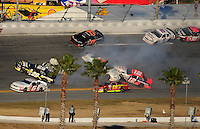 Feb 7, 2009; Daytona Beach, FL, USA; ARCA RE/MAX Series driver Justin Lofton (6) drives through a multi car accident involving Chris Cockrum (29) Matt Carter (46) Ryan Fischer (15) Eddie Mercer (51) Mario Gosselin (12) during the Lucas Oil Slick Mist 200 at Daytona International Speedway. Mandatory Credit: Mark J. Rebilas-
