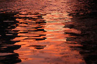 red sunset water reflection