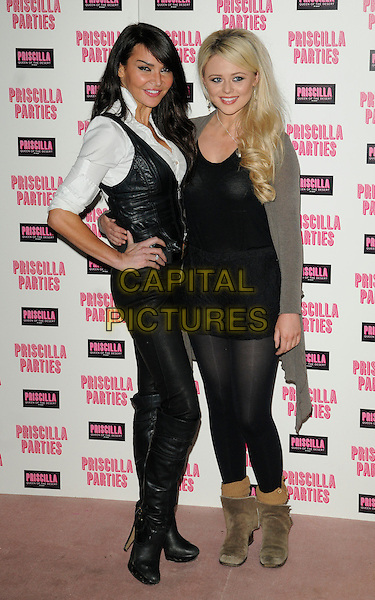 LIZZIE CUNDY & EMILY ATACK .Attending the launch of 'Priscilla Parties' at the Palace Theatre,  London, England, UK, January 24th 2011..full length white shirt hand on hip leather waistcoat Liz knee high boots tights playsuit ankle boots suede belt grey gray black  silver necklace smiling .CAP/CAN.©Can Nguyen/Capital Pictures.