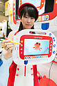 An booth assistant shows a ''Digital Sketchbook'' of MegaHouse at the International Tokyo Toy Show 2016 in Tokyo Big Sight on June 9, 2016, Tokyo, Japan. The annual exhibition showcases some 35,000 toys from 160 toy makers from Japan and overseas. The show runs to June 12th and organisers expect to attract 160,000 visitors. (Photo by Rodrigo Reyes Marin/AFLO)