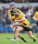 Stan Lineen of Ballyea in action against Michael O Loughlin of Clonlara during their senior county final replay at Cusack Park. Photograph by John Kelly.