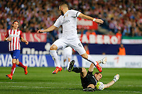 Real Madrid´s French forward Karim Benzema and Atletico Madrid's Slovenian goalkeeper Jan Oblak