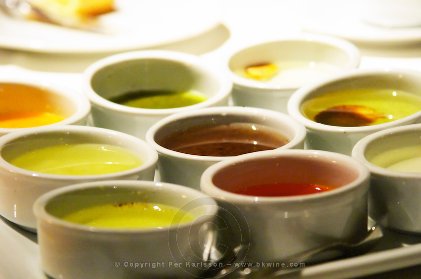 A selection of different kinds of oils. Each oil has a different taste and spice added to it and is of different colour The Rosa Negra Restaurant, The Black Rose, Buenos Aires Argentina, South America
