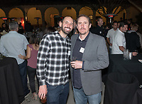 From left, Jason Muir '97 M'99 and Travis McKay '97<br /> Now in his 30th year as Oxy's head men's basketball coach, Brian Newhall received a much deserved celebration with a surprise halftime ceremony and post game reception in the Booth Hall courtyard with more than 70 former and current players from all different generations and decades in attendance, on Saturday, Jan. 26, 2019.<br /> Newhall is the winningest coach in Oxy history and has a 100 percent graduation rate in his 30 years at the helm of the program. His resume boasts multiple SCIAC Championships and NCAA Playoff appearances, along with a run to the NCAA Division III Elite Eight in 2003 and the only perfect 14-0 season in SCIAC history. Newhall has not only coached at Oxy, but was a SCIAC Champion and SCIAC Player of the Year during his playing career at Oxy in the early 80s.<br /> (Photo by Marc Campos, Occidental College Photographer)