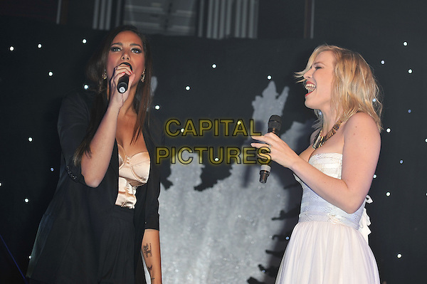Leona Lewis & Natasha Bedingfield.'Global Angels Awards', The Park Plaza Hotel, Westminster, London, England. 2nd December 2011..music on stage live concert gig performing half length microphone singing strapless white dress black jacket hand arm duet .CAP/MAR.© Martin Harris/Capital Pictures.