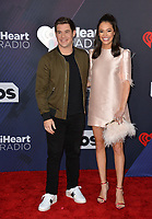 Adam DeVine &amp; Chloe Bridges at the 2018 iHeartRadio Music Awards at The Forum, Los Angeles, USA 11 March 2018<br /> Picture: Paul Smith/Featureflash/SilverHub 0208 004 5359 sales@silverhubmedia.com