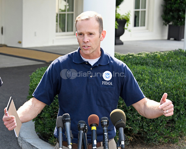 Federal Emergency Management Agency (FEMA) administrator Brock Long speaks to reporters outside the White House in Washington, DC about hurricane recovery efforts in Puerto Rico on Tuesday, September 26, 2017.<br /> Credit: Ron Sachs / CNP /MediaPunch