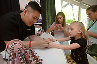 NWA Democrat-Gazette/BEN GOFF @NWABENGOFF<br /> Guests visit beauty suppliers Thursday, May 4, 2017, at the Sponsor Village at Compton Gardens during the Bentonville Film Festival.