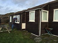 BNPS.co.uk (01202 558833)<br /> Pic: Peter Burridge/BNPS<br /> <br /> Pictured: The wooden shack before the being transformed into a luxury chalet.<br /> <br /> A couple who spent £450,000 on turning a 'rotting shed' into an exclusive seaside bolthole hope to recoup their money - by renting it out for £3,150 a week. <br /> <br /> Tracey Gilpin and Peter Burridge went out on a limb when they bought the 60-year-old wooden shack for a whopping £220,000.<br /> <br /> Despite its ramshackle condition, the cabin could command such a hefty asking price as it is located halfway up a cliff with stunning views of Whitsand Bay in Cornwall.<br /> <br /> But in order to make the coastal chalet a viable holiday let the couple had to demolish it and build a new one from scratch.