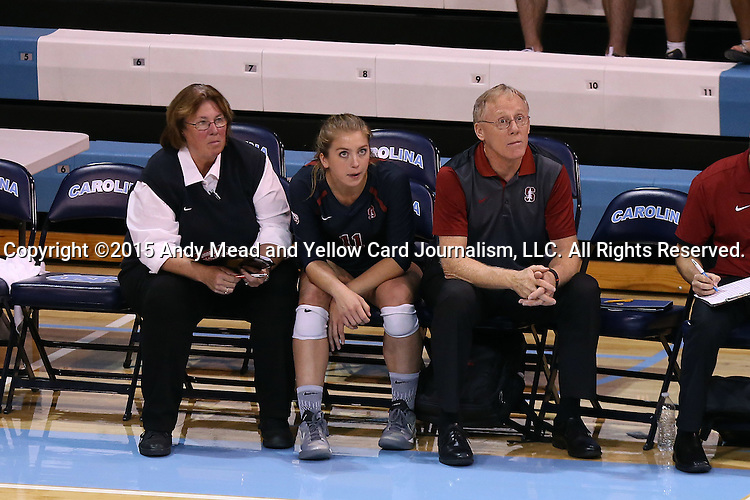 10 September 2015: Stanford head coach John Dunning (right) watches with Sidney Brown (11) and assistant coach Denise Corlett (left). The University of North Carolina Tar Heels hosted the Stanford University Cardinal at Carmichael Arena in Chapel Hill, NC in a 2015 NCAA Division I Women's Volleyball contest. North Carolina won the match 25-17, 27-25, 25-22.