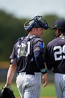 New York Yankees catcher Josh Breaux (20) talks with pitcher Roansy Contreras (29) during a Florida Instructional League game against the Philadelphia Phillies on October 11, 2018 at Yankee Complex in Tampa, Florida.  (Mike Janes/Four Seam Images)