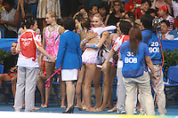 August 23, 2008; Beijing, China; (Center) Rhythmic gymnast Inna Zhukova of Belarus is congratulated by Almudena Cid of Spain upon winning silver in the All-Around final at 2008 Beijing Olympics. (©) Copyright 2008 Tom Theobald.
