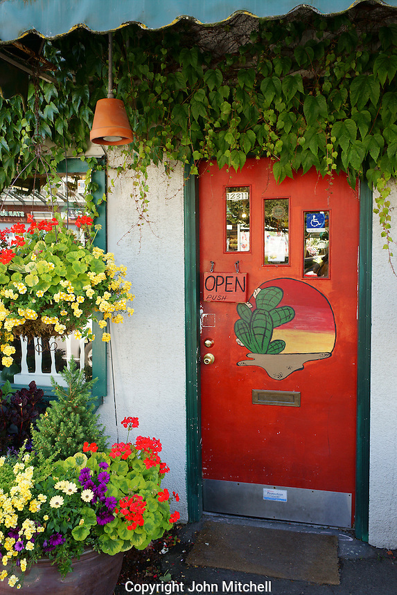 Red front door of a plant nursery in the village of Steveston, British Columbia, Canada