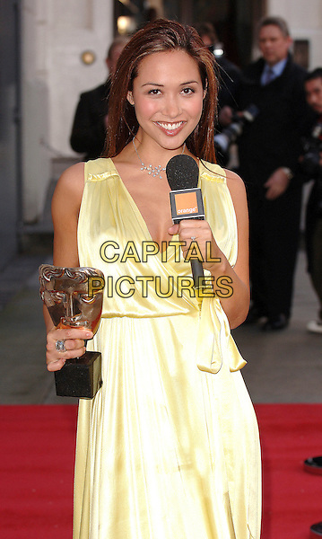 """MYLEENE KLASS.the """"I'm A Celebrity Get Me Out Of Here"""" star  poses outside The Royal Opera House in Covent Garden, London, England 6th February 2007..She will be presenting the Orange Red Carpet Show from the BAFTA red carpet this Sunday..half length yellow silk satin dress red carpet microphone holding award trophy.CAP/ BEL.©Tom Belcher/Capital Pictures."""