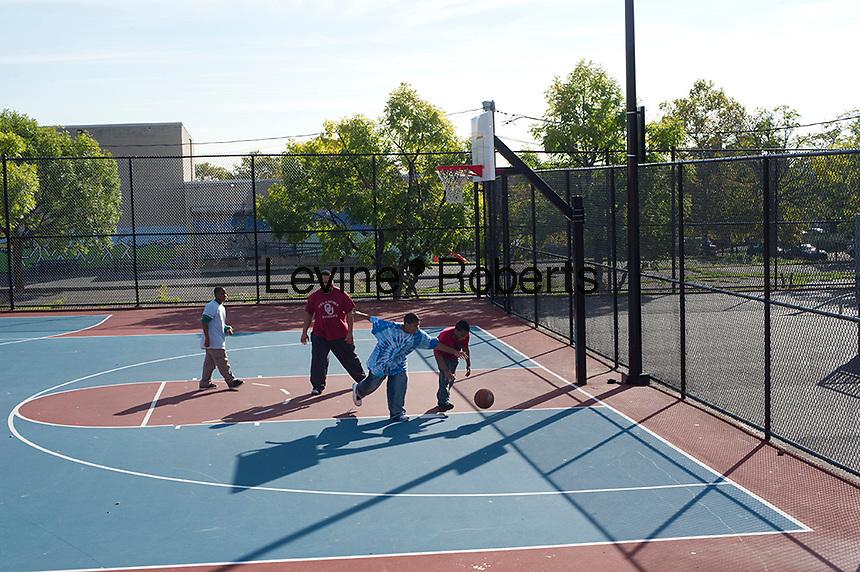 Kids playing basketball at the basketball courts.  Jesse Allen Park Phase II Opening Celebration, Newark, NJ on Wednesday, October 17, 2012.  (© Frances M. Roberts)