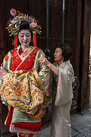 "Japan; Kyoto. Kikugawa, a Tayu or Oiran. Once known as a courtesans, they are highly educated in tea cermony, flower arranging, playing music, calligraphy, are well read and good conversationists. Her black teeth are a sign of beauty. Therare about 5 tayu today, compared to about 300 geisha. ""A tayu is my ideal woman image, I chose to be one. I was also concerned that this culture would disappear."" Attended by her ""mother,"" who was also a Tayu. Model released."
