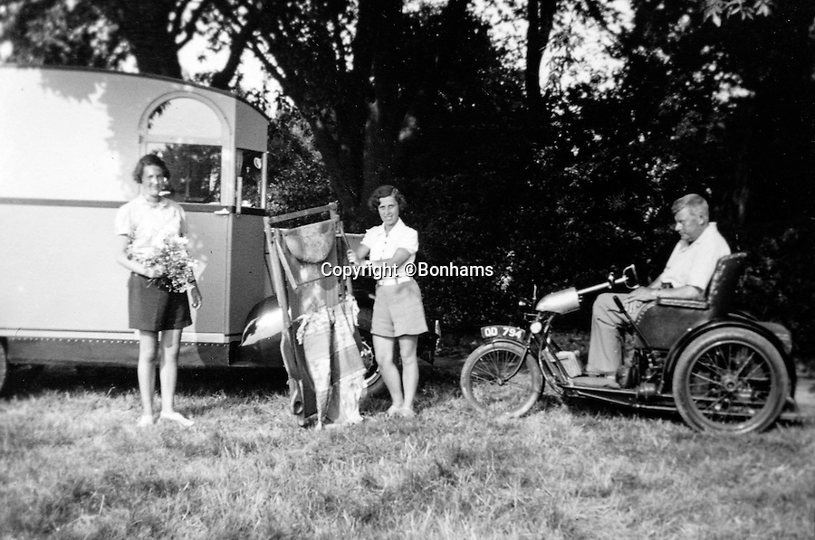 BNPS.co.uk (01202 558833)<br /> Pic: Bonhams/BNPS<br /> <br /> Capt Dunn with familyon a pre war outing in the motorhome.<br /> <br /> The interior was designed around Capt Dunn's wheelchair after he contracted polio on his honeymoon.<br /> <br /> Britain's first motorhome revealed - As eccentric British pioneers 80 year old home on wheels trundles up for auction.<br /> <br /> The pre-war creation of Capt Dunn, an aristocrat from Bexhill-on-Sea, is believed to be the earliest motorhome in the UK.<br /> <br /> Enterprising Dunn shipped a Pontiac Six chassis over from America in 1935, engaged local coach builders to craft a bespoke<br /> <br /> home from home on to the back, and then set off into the British countryside in his new creation.<br /> <br /> The unique vehicle has been untouched since Dunn died in the 1940's and auctioneers Bonhams are now selling the time capsule<br /> <br /> camper at the Goodwood Revival on 10th September with a £40,000 estimate.