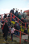 Sheffield United 2 Leeds United 0, 19/03/2011. Bramall Lane, Championship. Sheffield United supporters making their way out of the Kop Stand and the end of the Npower Championship fixture with Leeds United. The home team won the game by two goals to nil watched by a crowd of 23,728. Bramall Lane is the world's oldest professional football ground and at one time hosted both football and cricket. Photo by Colin McPherson.