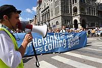 Helsinki Calling peace marchers begin their march from City Park to Senate Square a day ahead of the summit between US President Donald Trump and Russian President Vladimir Putin in Helsinki, Finland on July 15, 2018.