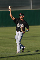 Fidel Pena (18) of the Visalia Rawhide throws before a game against the Lancaster JetHawks at The Hanger on June 16, 2015 in Lancaster, California. Lancaster defeated Visalia, 11-3. (Larry Goren/Four Seam Images)