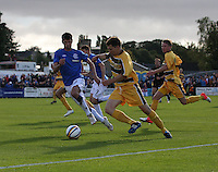 Scott Lawrie crossing as Emilson Cribari comes across in the Forres Mechanics v Rangers William Hill Scottish Cup 2nd Round match, at Mosset Park, Forres on 29.9.12..