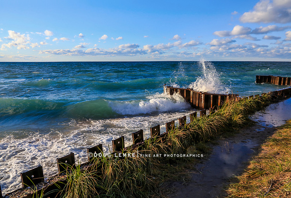 Waves Rolling Toward The Seawall At The Point Betsie Lighthouse On Lake Michigan, USA