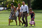 United States President Barack Obama, First Lady Michelle Obama and daughters Sasha and Malia return to the White House in Washington, D.C. aboard Marine One following their weekend vacation in Maine on Sunday, July 18, 2010.  .Credit: Kristoffer Tripplaar / Pool via CNP
