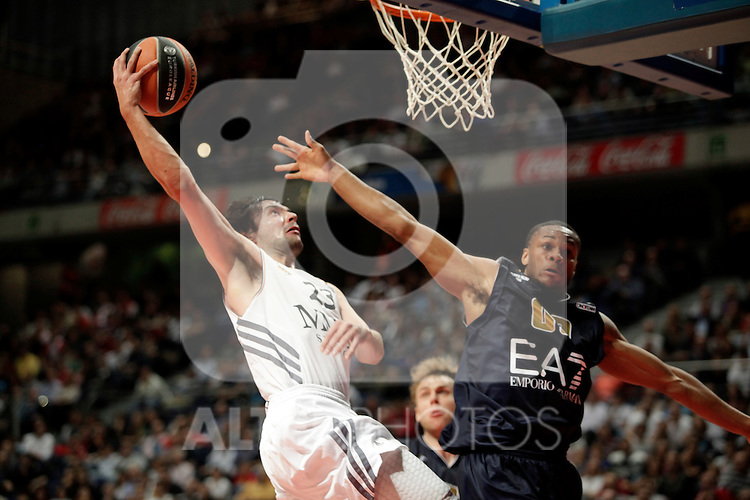 Real Madrid´s Sergio Llull (L) V EA7 Emporio Armani Milan´s Hayne (R) during Euroleague Basketball match. November 01,2013. (ALTERPHOTOS/Victor Blanco)