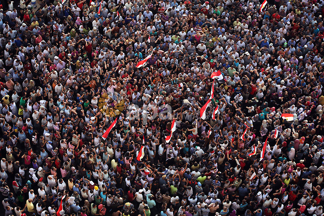A view taken from a building overviewing Tahrir square shows Egyptian protesters shouting slogans against former President Hosni Mubarak and his aides during a demonstration hours after the announcement of the verdict in their trial, in Tahrir square, Cairo, Egypt, 02 June 2012. Former Egyptian president Hosni Mubarak and his former interior minister Habib al-Adly were on 02 June sentenced to life imprisonment theafter a court found him guilty of complicity in the killing of peaceful protesters during the 2011 uprising. The judge however, said that Mubarak, and his two sons, Alaa and Gamal, were found not guilty of corruption and influence peddling. Egypt's top prosecutor ordered that former president Hosni Mubarak be transferred from a military hospital to a prison facility near Cairo. Photo by Ashraf Amra