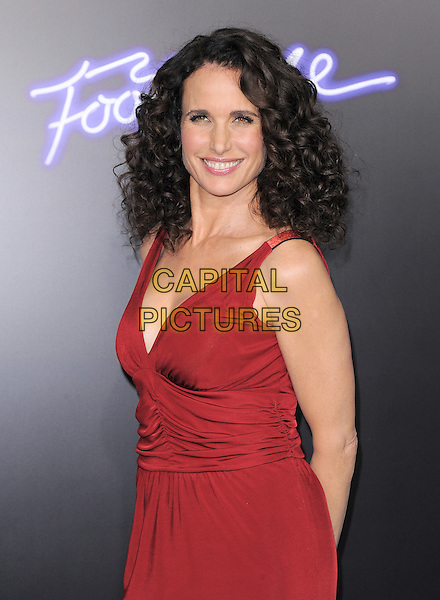 Andie MacDowell .The L.A. Premiere of 'Footloose' held at The Regency Village Theater in Westwood, California, USA..October 3rd, 2011.half length red sleeveless dress  .CAP/RKE/DVS.©DVS/RockinExposures/Capital Pictures.