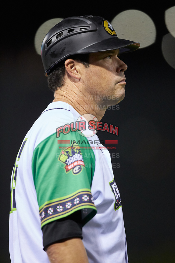 Caballeros de Charlotte manager Mark Grudzielanek (15) coaches third base during the International League game against the Buffalo Bisons at BB&T BallPark on July 23, 2019 in Charlotte, North Carolina. The Bisons defeated the Caballeros 8-1. (Brian Westerholt/Four Seam Images)