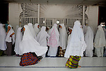 Students prepare to pray at a mosque of their state Islamic boarding school, which offers both national and Islamic curriculum, in Banda Aceh, Indonesia, on Tuesday, Nov. 10, 2009.