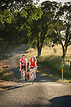 Bicycle riding along a country road in Amador County, California...Hared & Samantha Saldate and Jessie Larson..Model Released