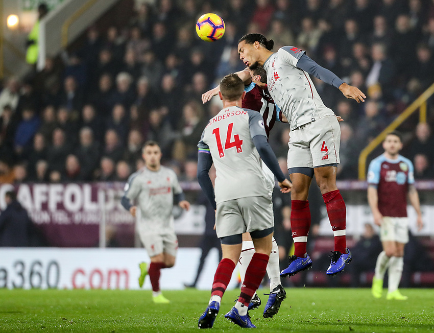 Burnley's Chris Wood competing with Liverpool's Virgil van Dijk<br /> <br /> Photographer Andrew Kearns/CameraSport<br /> <br /> The Premier League - Burnley v Liverpool - Wednesday 5th December 2018 - Turf Moor - Burnley<br /> <br /> World Copyright © 2018 CameraSport. All rights reserved. 43 Linden Ave. Countesthorpe. Leicester. England. LE8 5PG - Tel: +44 (0) 116 277 4147 - admin@camerasport.com - www.camerasport.com