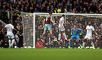 Sunday 07 December 2014<br /> Pictured: Andy Carroll of West Ham (9) heads the ball in to equalise, Angel Rangel of Swansea fails to prevent him<br /> Re: Premier League West Ham United v Swansea City FC at Boleyn Ground, London, UK.