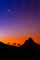 Lion's Head Mountain at twilight with rising moon above, Cape Town, South Africa.