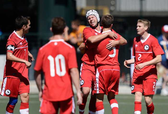 Toronto, ON - Aug 9 2015 -  Dustin Hodgson, Kyle Payne, Sam Charron and Liam Stanley join Trevor Stiles in celebrating his goal as Canada takes on the United States in Football 7-a-side at the Parapan Am Fields during the Toronto 2015 Parapan American Games  (Photo: Matthew Murnaghan/Canadian Paralympic Committee)